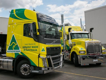Two prime movers painted in 'Proudly Made in Australia' livery.